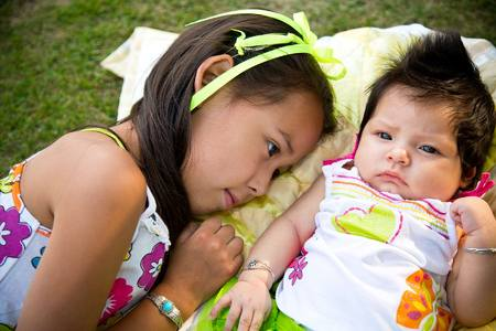 Heather's daughters, Lanaiya (age 5) and infant Tahlia (2 months).