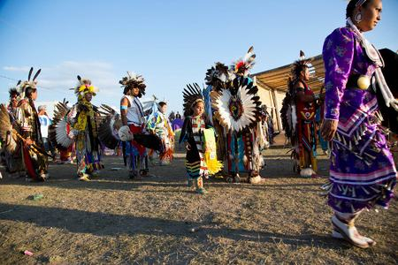 Dancers line up for Grand Entry at the Heart Butte Pow Wow