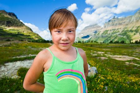Annie Whitney (age 6), stands at Logan Pass on the Going to the Sun Highway during a field trip to Glacier National Park with the Browning Boys & Girls Club. Before it became a national park, this land belonged to the Blackfeet Tribe.