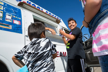 Browning kids are thrilled for the arrival of the Kool Breeze Ice Cream Truck on their street.