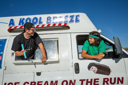 Left to right, Ian Webber (22) and Robert Hall (27) take a break and enjoy some ice cream.