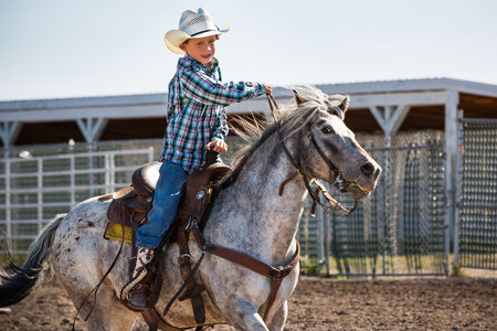 Rhett Michael (8) rides his horse, SuzyQ in the barrel race at the Youth Rodeo.