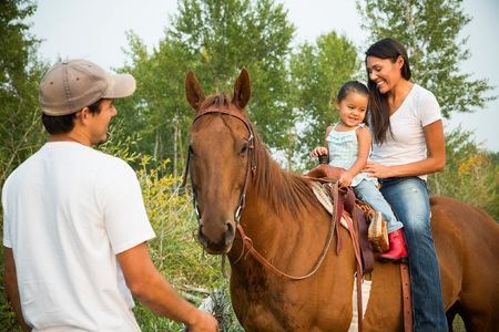 Kendall Edmo with her boyfriend, Andrew and her 2 year old daughter at her family home in Two Medicine on the Blackfeet Reservation.